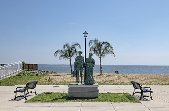 A sculpture depicting two Gilded Age vacationers greets beach goers on the waterfront at Colonial Avenue. - SCOTT ELMQUIST